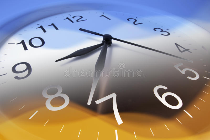 Clock Face. In Blue and Warm Tones stock photos