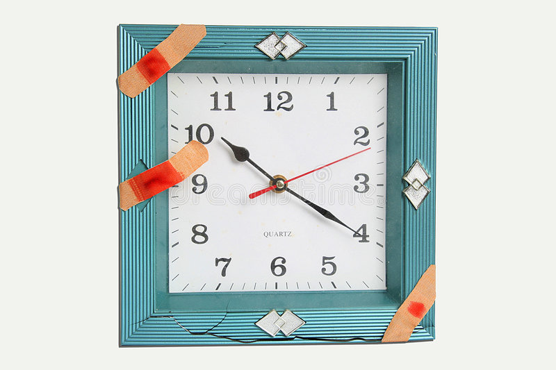 Clock face with bandages. A view of an analog clock face in a blue frame with three bandages. Theme: time heals stock photos