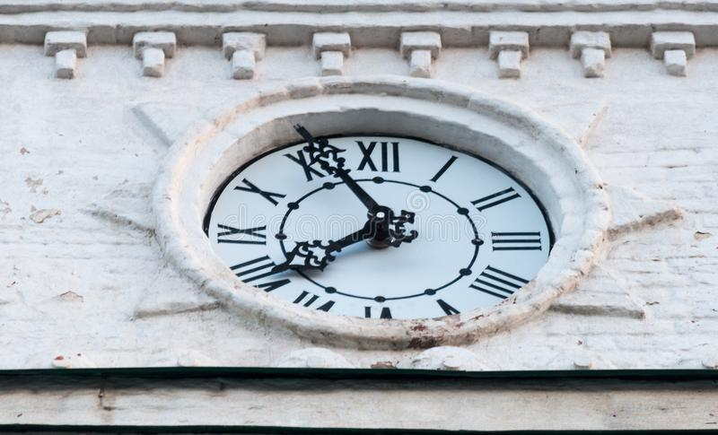 Clock face from the clock tower. the hands of time. White dial. black arrows and black numbers. time royalty free stock image