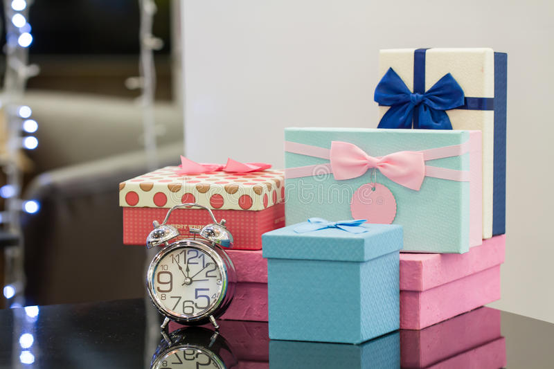 Clock of Gift. Alarm clock and gift box with copy space stock image