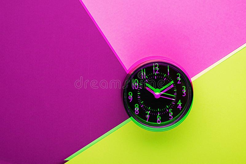 The clock glitch is a duo-tone effect in bright neon, modern colors. Retro wave. Plastic pink, ufo green, proton purple royalty free stock photography