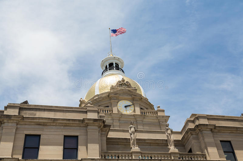 Clock Gold Dome and American Flag on City Hall royalty free stock photo