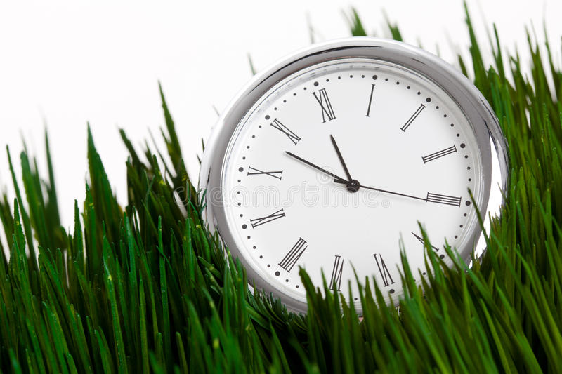 Download Clock And Green Grass Stock Photos - Image: 24096303