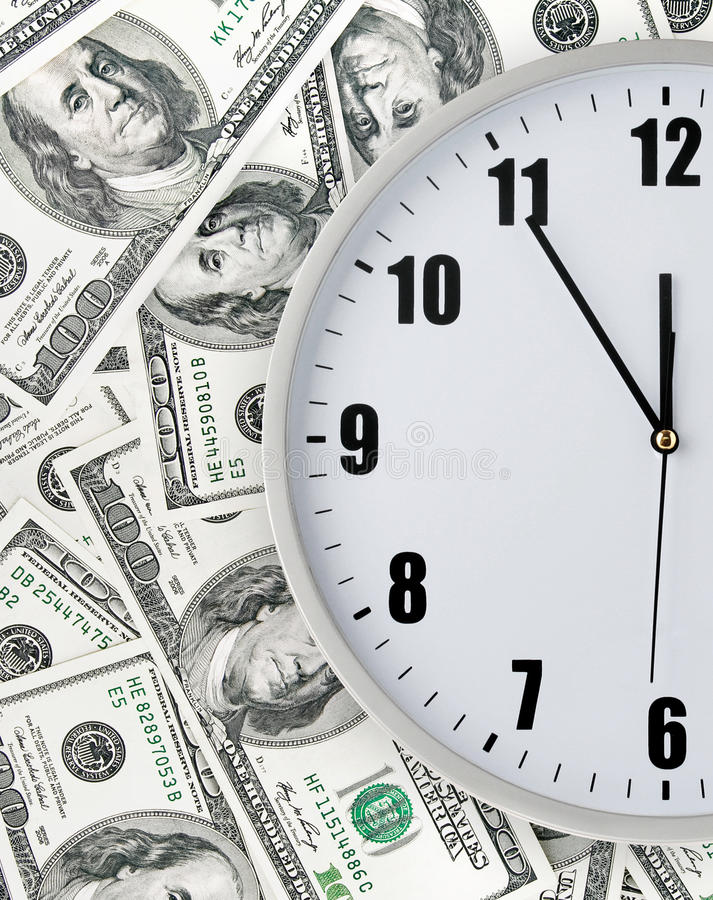 Clock with hand on money background. Clock with hand on many money background stock image