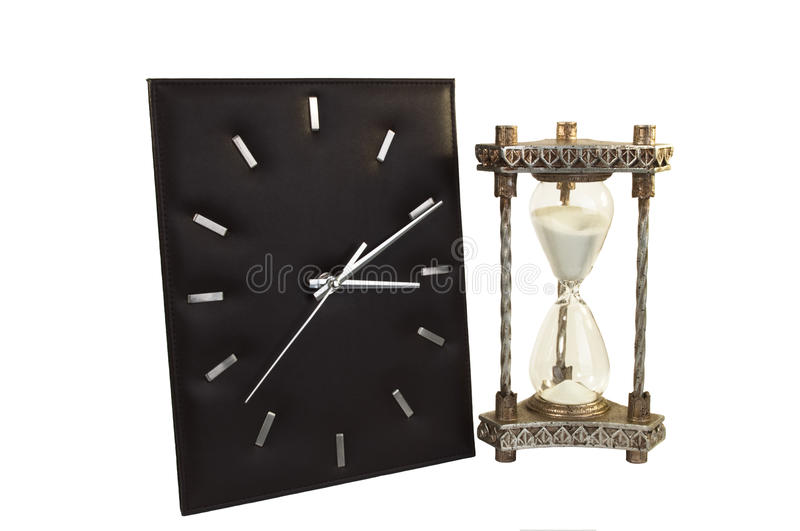 Clock and Hour Glass. Modern Clock and Old Hour Glass Isolated on White stock photos