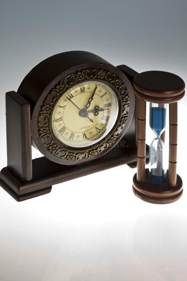 Clock and hourglass stock photos