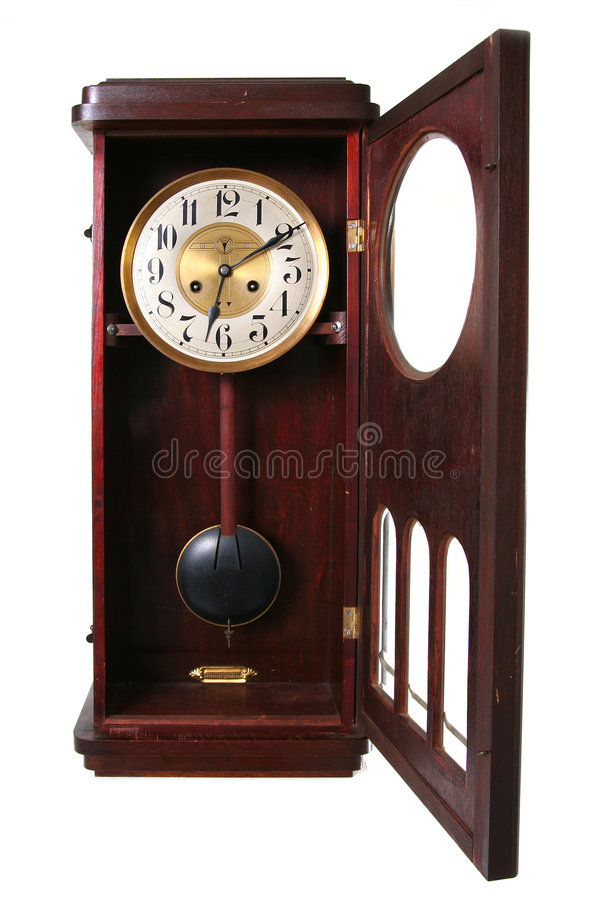 Clock isolated. Old wall clock isolated on white. antique wood time piece with pendulum stock image