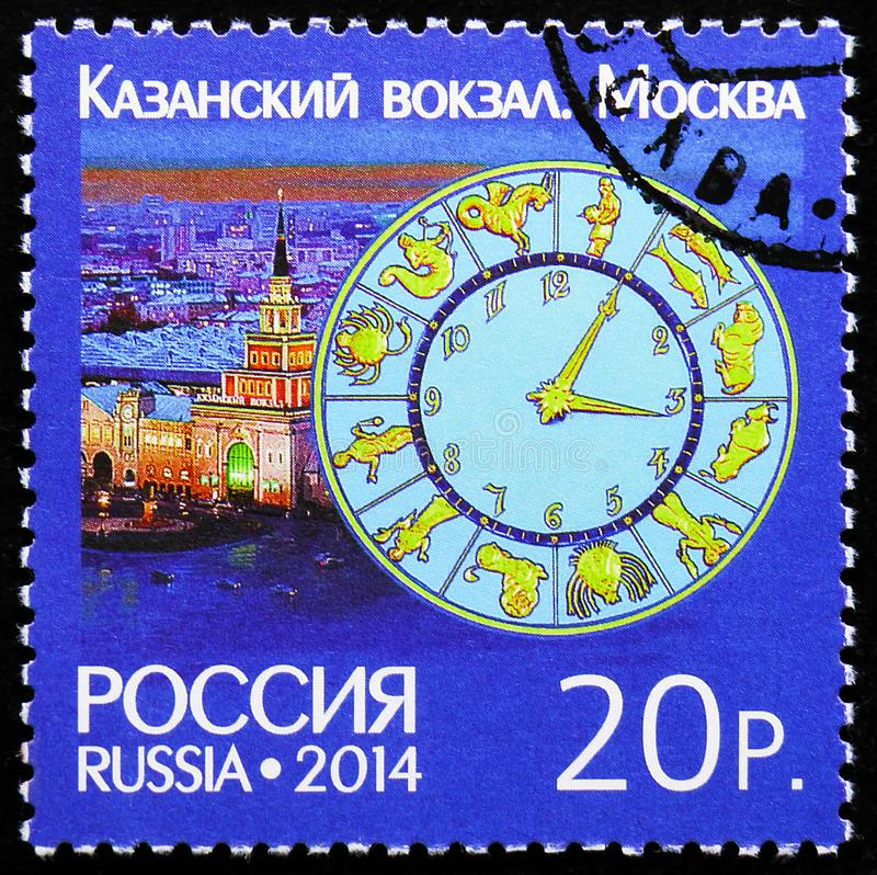 Clock on Kazan Railway Station in Moscow, Joint issue of Russia and Switzerland, Clock Towers serie, circa 2014 royalty free stock photo