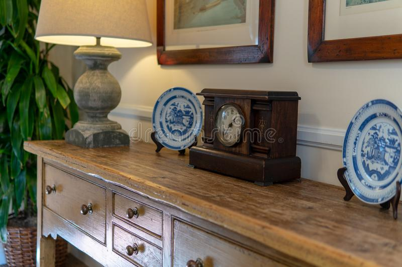Clock and Lamp - Home Decor. Upham Hotel in Santa Barbara, California, nature, agriculture, alarm, art, beautiful, bedside, book, clock, color, decor, decoration royalty free stock images