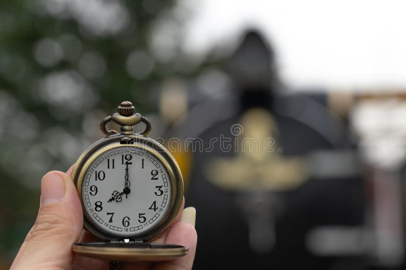Clock with lid shows at 8 o`clock on Steam Locomotives blurred stock photo
