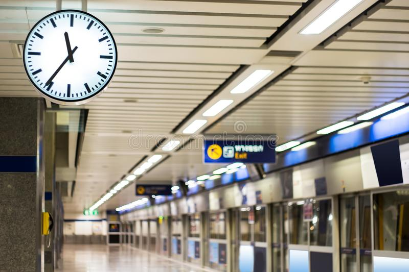 A clock for looking the time at subway platform stock photos
