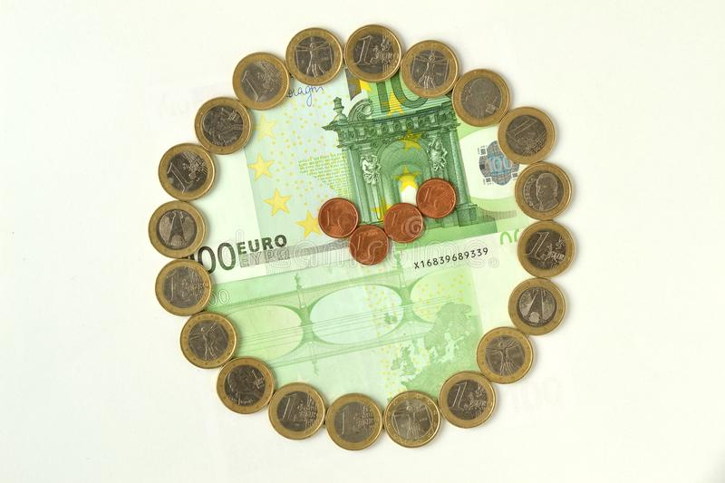 Clock made out of euro coins and banknotes - Time is money royalty free stock photo