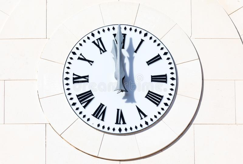 Clock marks 12 o`clock 00:00 h, 12:00 h, 24:00 h, twelve hours. New Year`s Eve bells New Year`s Eve at Christmas. stock image