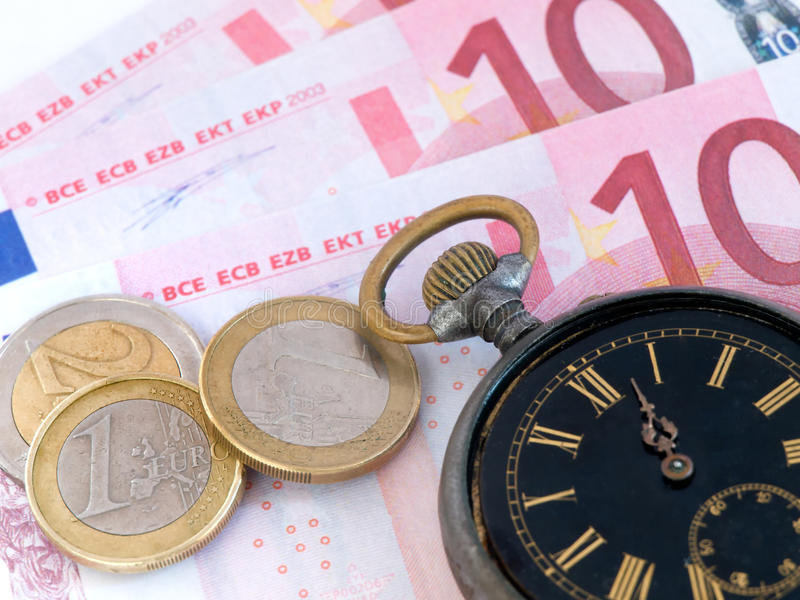Clock And Money Stock Photography