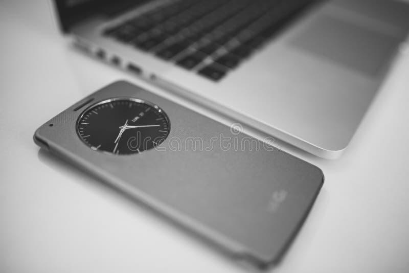 Clock Next To Open Laptop Free Public Domain Cc0 Image