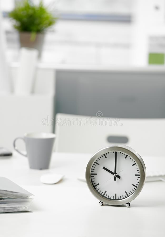 Download Clock on office desk stock image. Image of room, close - 17628041