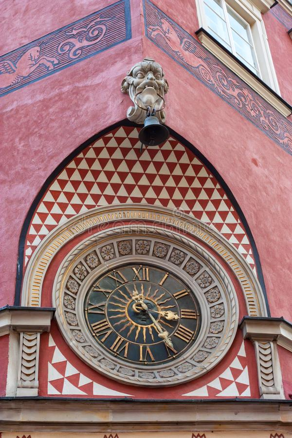 Clock on old Town Market in Warsaw, Poland. Beautiful colorful clock on old Town Market in Warsaw close up stock image
