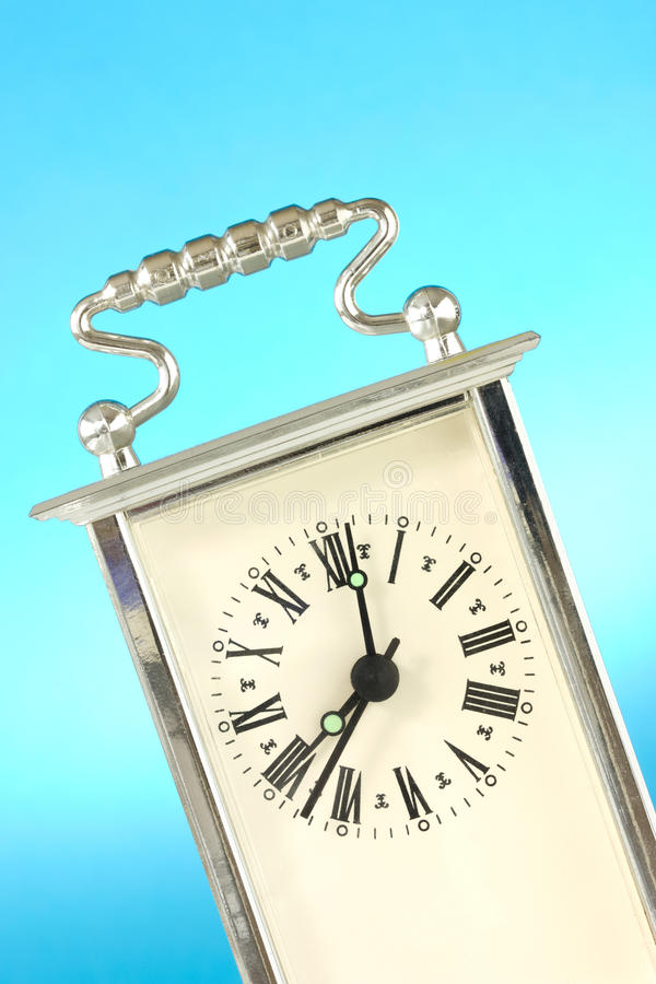 Download Clock  Over A Blue Background Stock Photo - Image: 24556514