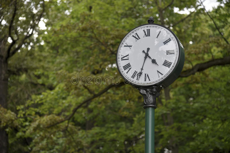 Clock in the park, a symbol of time stock images