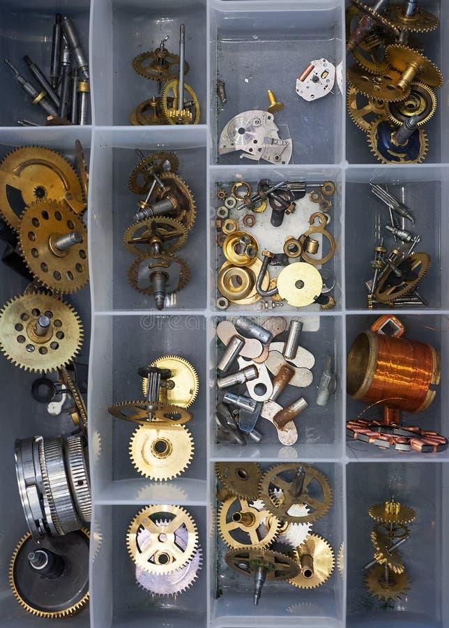 Clock parts. A lot of clock parts in box royalty free stock photos