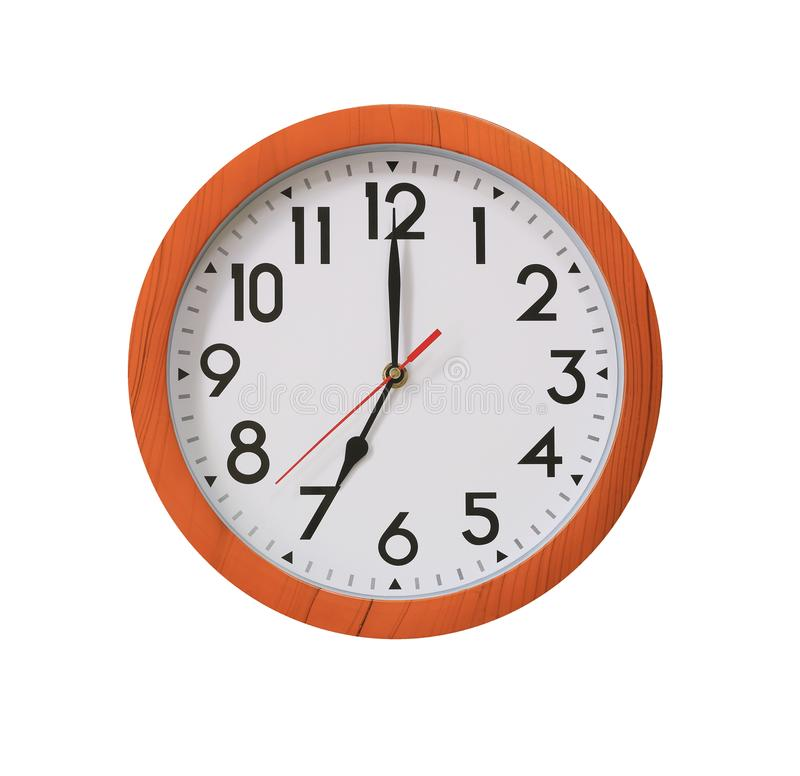 Clock of pattern brown wood in seven o'clock isolated on white b. Ackground and have clipping paths with create from pen tool function stock image