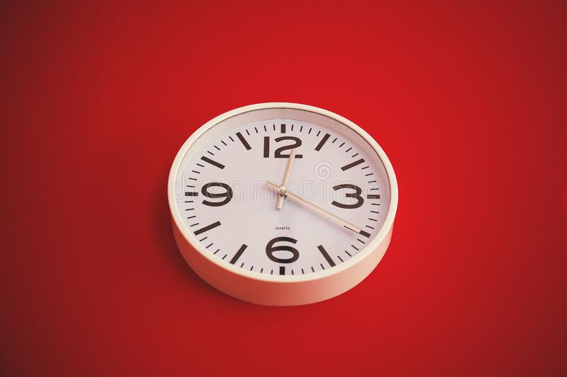 Clock on red wall royalty free stock photography