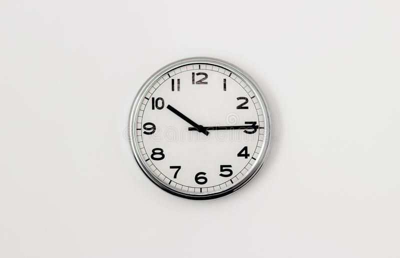 Clock 10:15. Round clock face displaying quarter past 10 stock image