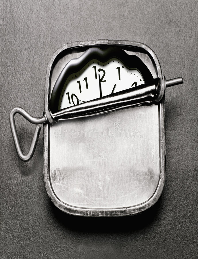 Clock in sardine can. Clock compressed in sardine can stock photography