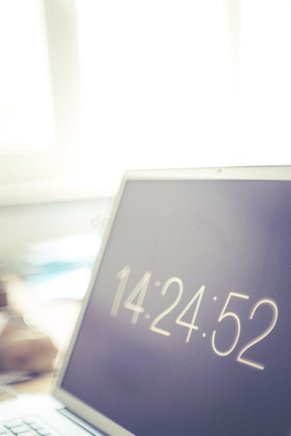 Clock screensaver on laptop royalty free stock photo