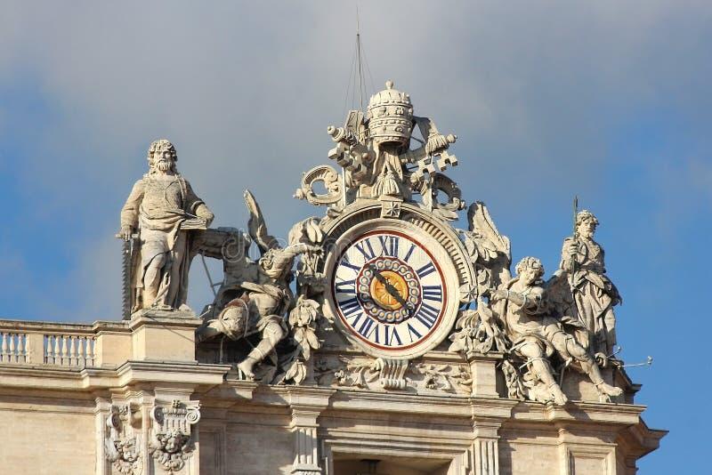 Clock with sculptures at Saint Peter basilica in Vatican royalty free stock photos