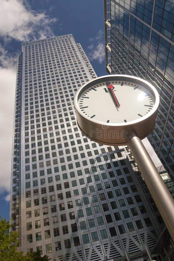 Clock showing noon. In Canary Wharf, London stock photography