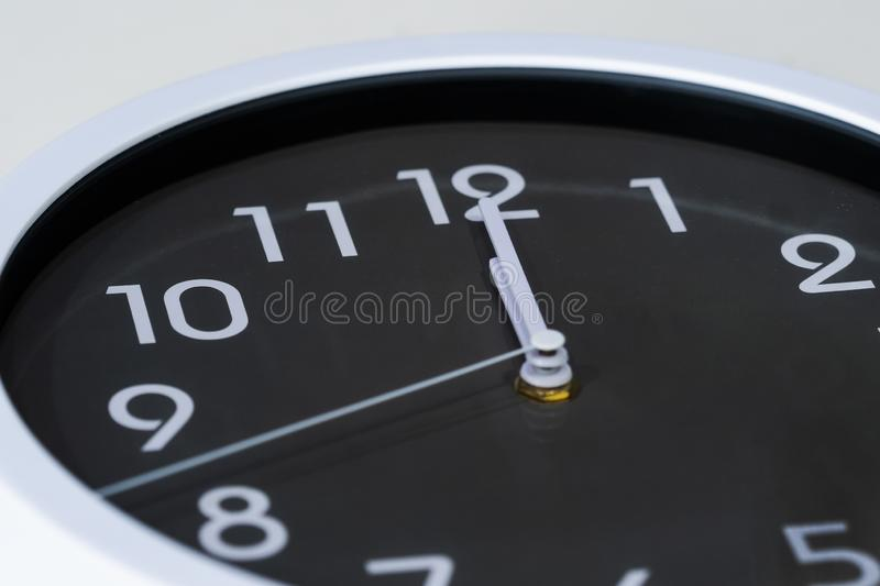 Clock showing at noon stock photography