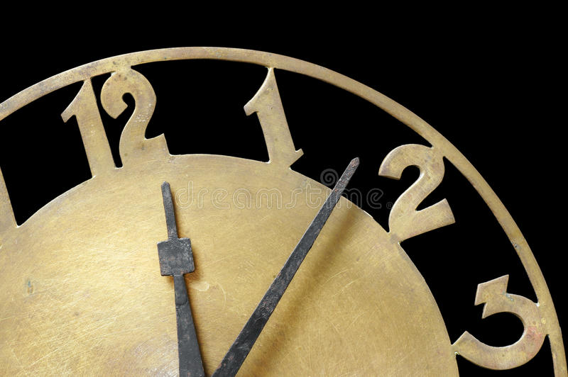 Clock showing time. Old metal clock showing the time royalty free stock photography