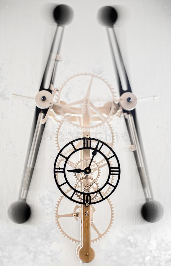 Clock with swinging moving parts royalty free stock photos