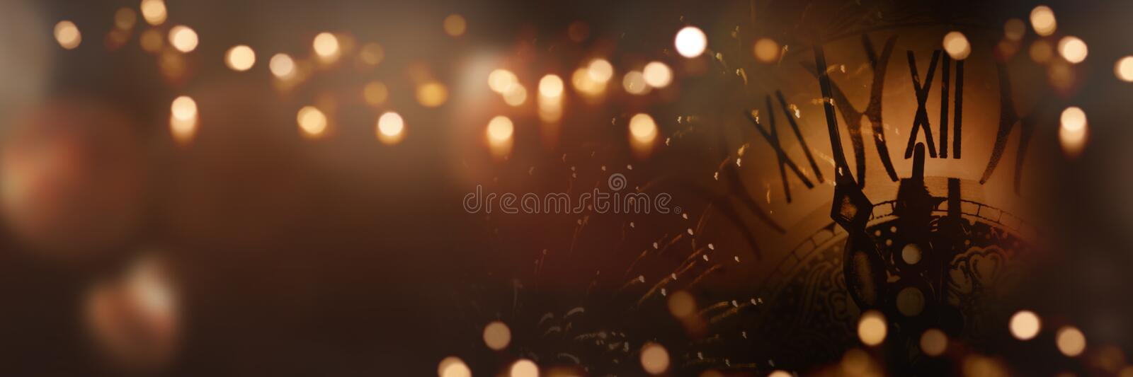 Clock time in the night of new year. With festive golden lights stock image