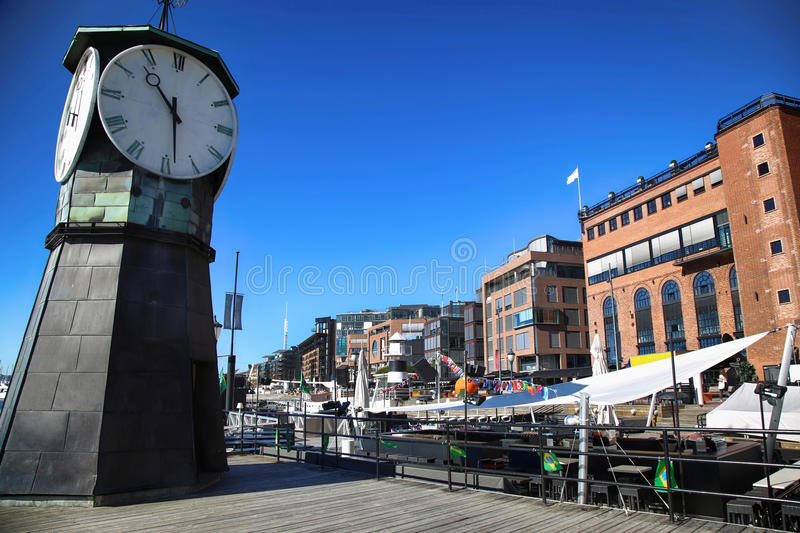 Clock tower on Aker Brygge Dock and modern building in Oslo, Nor royalty free stock image