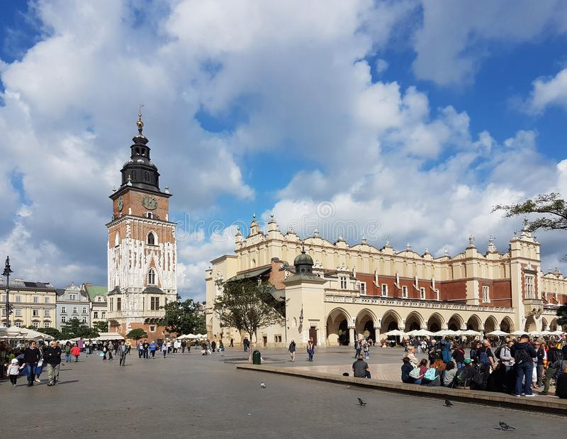 A clock tower and a bazaar. The central square of the city of Krakow. Medieval architecture of Poland. A bright sunny day after the rain. autumn of 2017 stock photo
