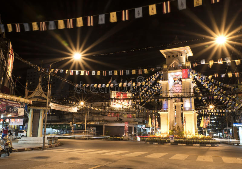 The clock tower of Betong, Thailand. BETONG, THAILAND - DECEMBER 10: The clock tower of Betong, Thailand with the usual traffic in Betong, Thailand on December stock photography