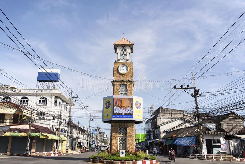 The clock tower of Betong, Thailand. BETONG, THAILAND - DECEMBER 10: The clock tower of Betong, Thailand with the usual traffic in Betong, Thailand on December royalty free stock photography