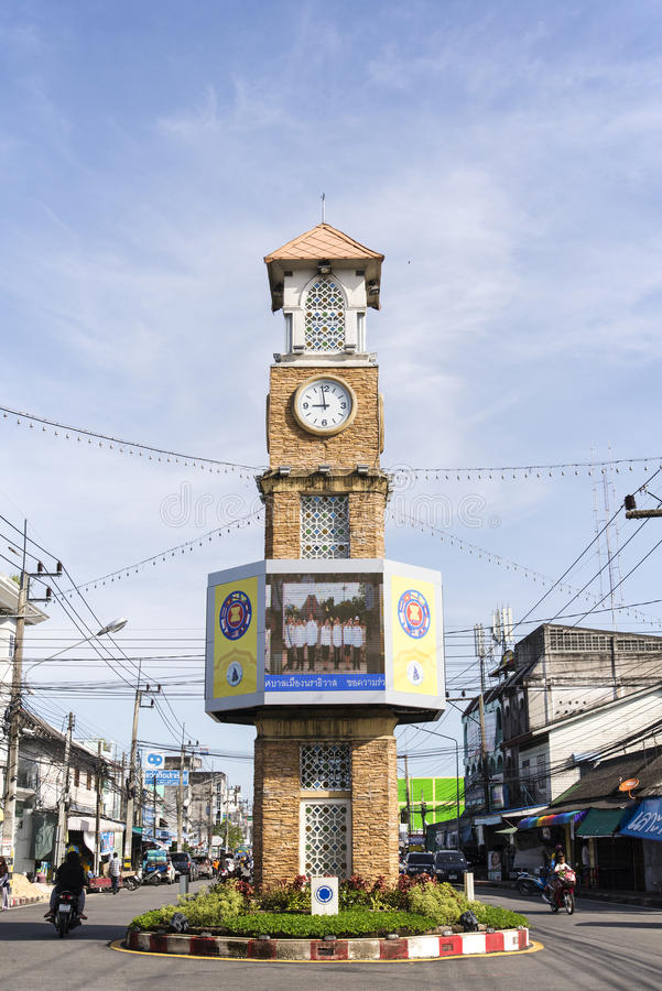The clock tower of Betong, Thailand. BETONG, THAILAND - DECEMBER 10: The clock tower of Betong, Thailand with the usual traffic in Betong, Thailand on December royalty free stock image