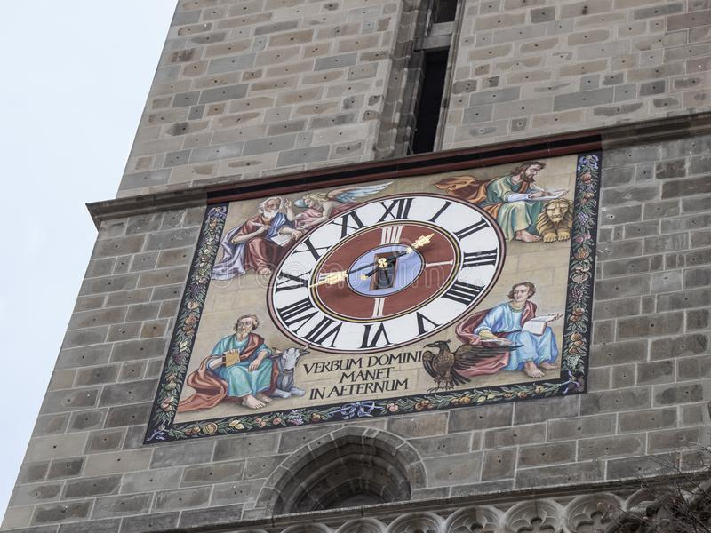 Clock on the tower of the Black Church, built in the Gothic style and named after the dark color left after the fire. Of the 17th century in the Brasov city in stock images