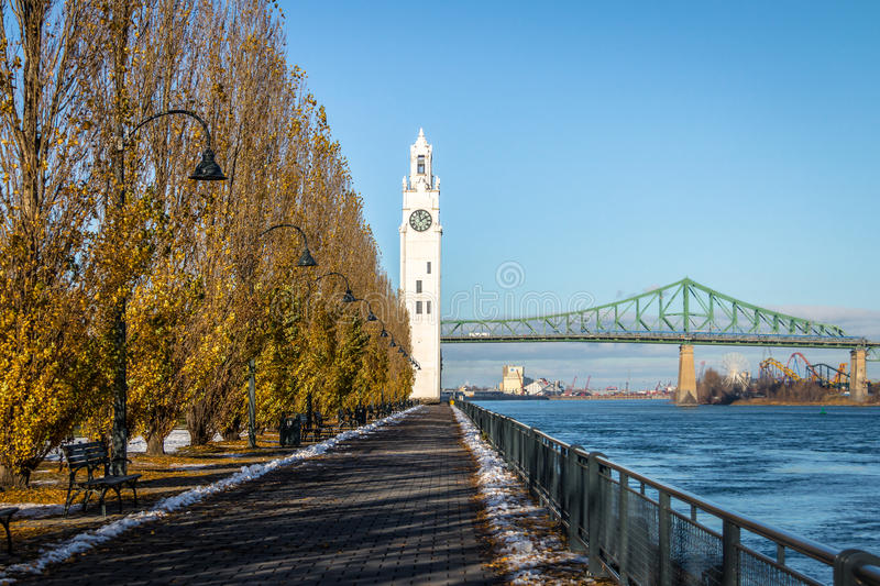 Clock Tower and Jacques Cartier Bridge at Old Port - Montreal, Quebec, Canada. Clock Tower and Jacques Cartier Bridge at Old Port in Montreal, Quebec, Canada stock photo