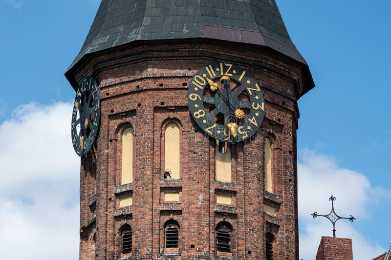 Clock tower of Konigsberg Cathedral. Brick Gothic-style monument in Kaliningrad, Russia. Immanuel Kant island stock images