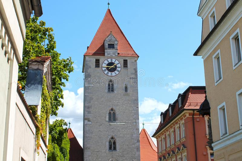 Clock tower in medieval town Regensburg. Germany. View of Clock tower in medieval town Regensburg. Center of the city is a UNESCO World Heritage.  Bavaria royalty free stock photography
