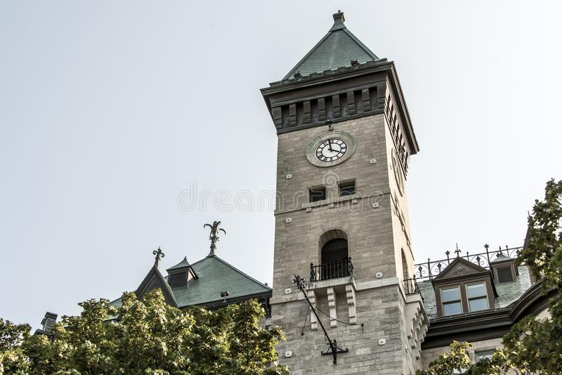 Clock tower of the old building - Quebec City, Canada. Clock tower of the old building Quebec City, Canada royalty free stock images