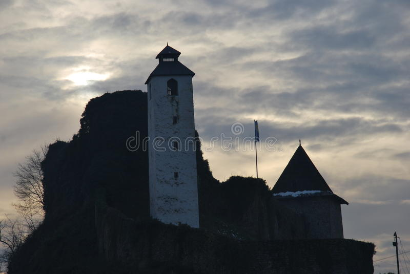 Clock tower on the old fortress, Bosnia and Herzegovina. Picture tells a story about the past, present and future of one region! -White `Clock Tower` that now stock images