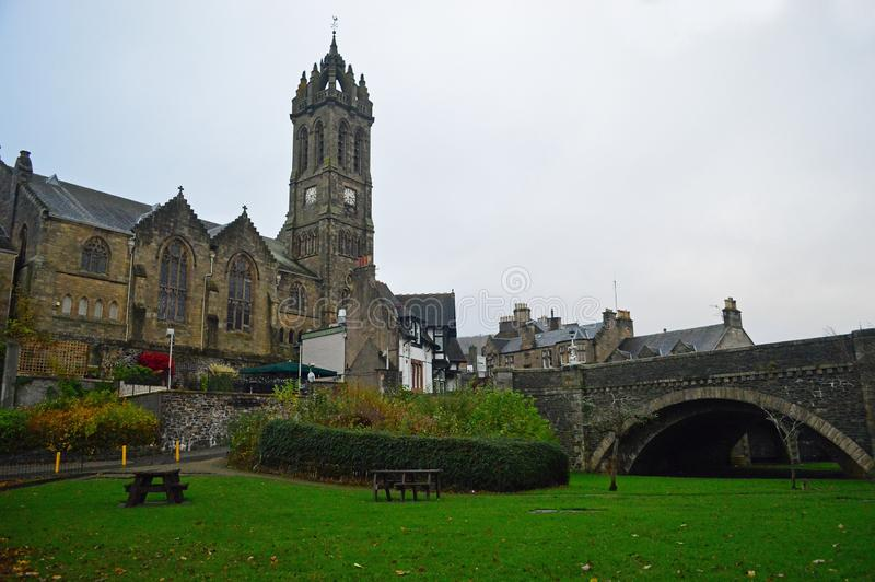 The clock Tower of the old parish church in peebles and the Tweed bridge. Peebles is a royal burgh in Peeblesshire, of which it is the county town, within the stock images
