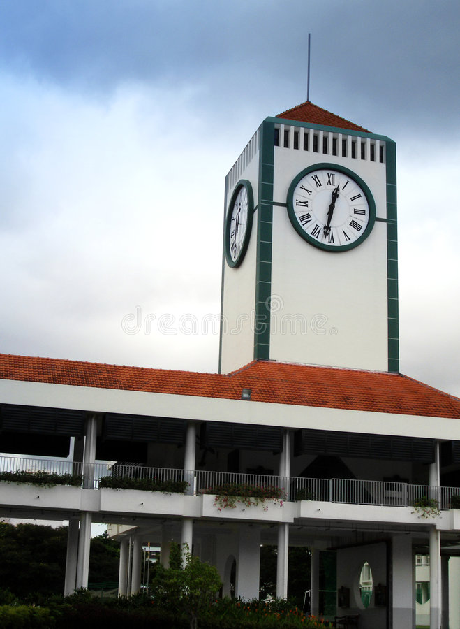 Clock tower in school. A modern contemporary clock tower in a secondary school of Singapore stock photography