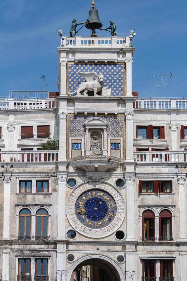 The clock tower St. Mark`s at St. Mark`s Square in Venice, Italy stock photo