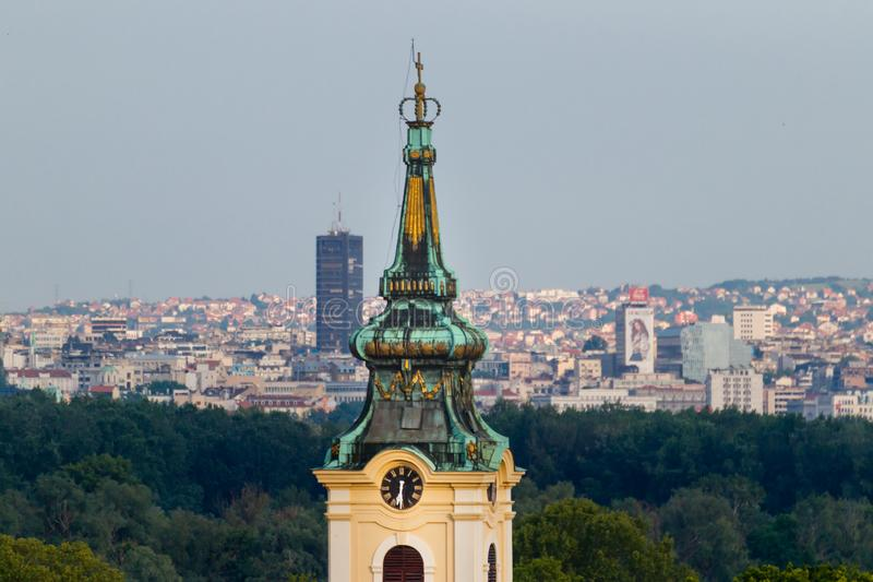 Clock tower on ortodox church with Belgrade in the distance stock image